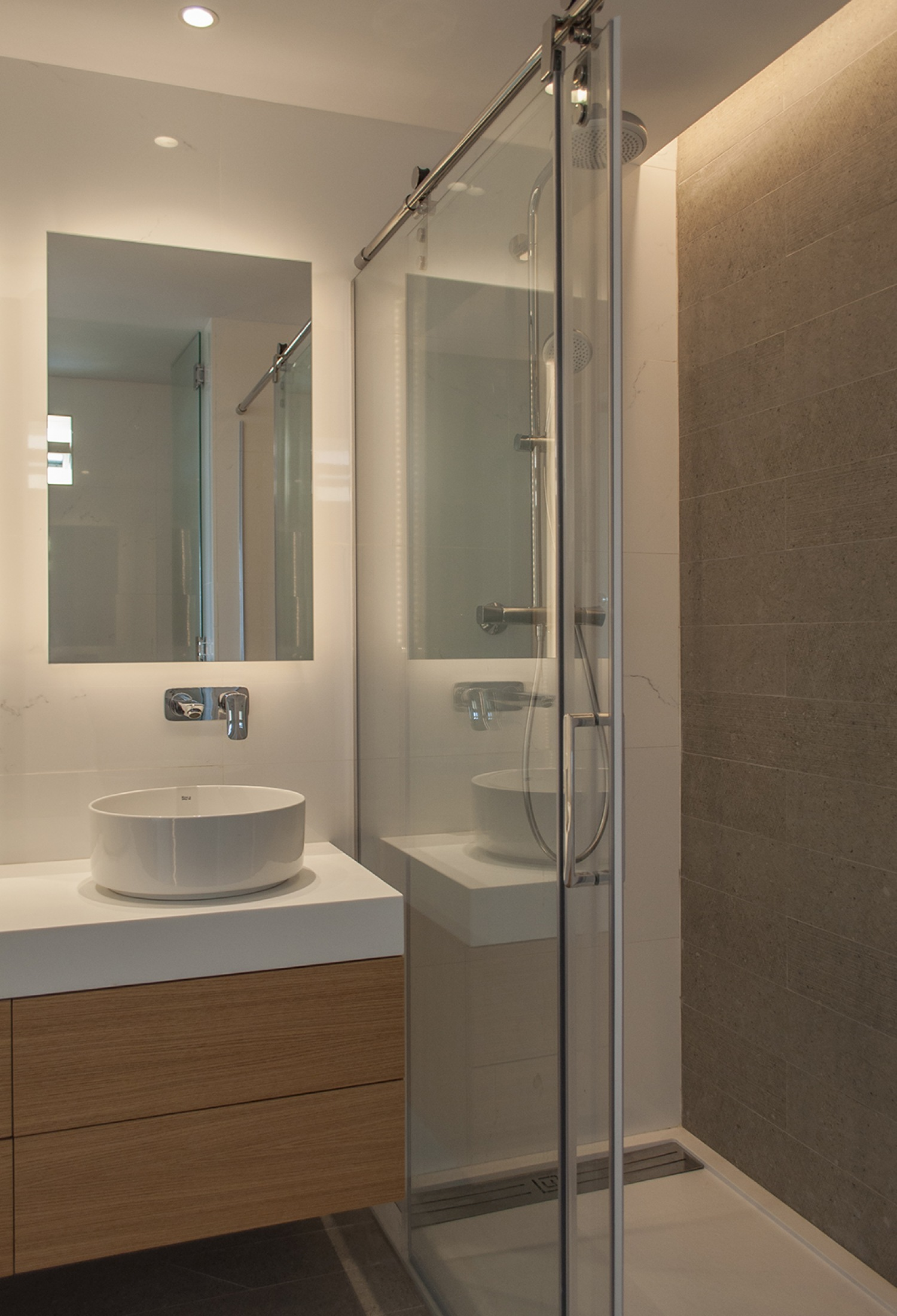 16-architecture-sitges-interior-design-barcelona-modern-bathroom-shower-krion-wood-furniture